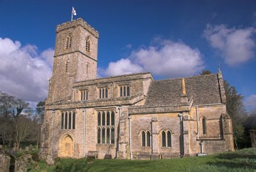 St John the Evangelist. The church has a tall west tower, chancel, nave with clerestory, south porch and north and south transepts.